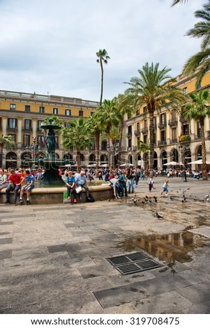 BARCELONA, SPAIN - MAY 02: Groups of Tourists Gathered Around Central Water Fountain in Placa Reial, a Popular Tourist Destination in Barcelona, Spain, May 02, 2015 - stock photo
