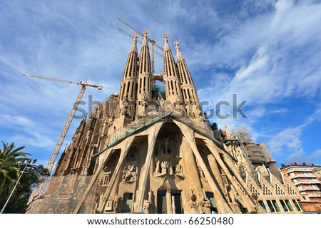 BARCELONA, SPAIN-MAY 10:La Sagrada Familia- a large Roman Catholic church, designed by Gaudi in Barcelona, on May 10, 2010. The church is a UNESCO World Heritage Site. - stock photo