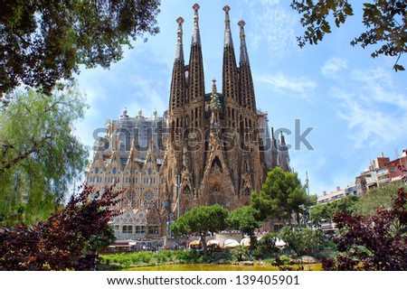 BARCELONA, SPAIN - MAY 28: La Sagrada Familia on May 28,2012, designed by Antoni Gaudi. Is a large Roman Catholic church in Barcelona, which is being build since March 19,1882 and is not finished yet - stock photo
