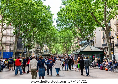 BARCELONA, SPAIN - MAY 2: Las Ramblas on May 2, 2014 in Barcelona.Thousands of people walk daily by this popular pedestrian street.  - stock photo
