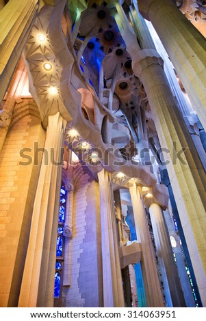 BARCELONA, SPAIN - MAY 02: Low Angle View of Unusual Architectural Interior of Sagrada Familia Church, Designed by Antoni Gaudi, Barcelona, Spain - Detail of Pillars and Ceiling. May 02, 2015. - stock photo