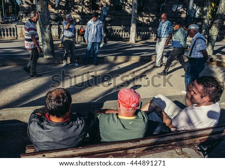 Barcelona, Spain - May 22, 2015. Men plays boules game at Lluis Companys Promenade in Barcelona