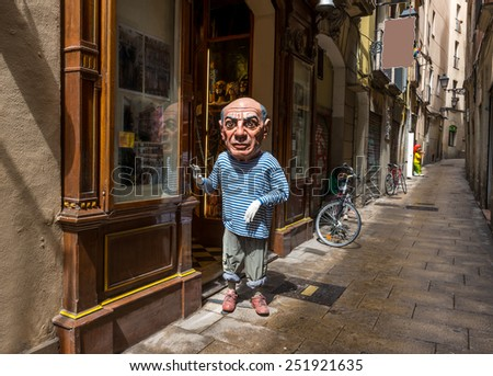 BARCELONA, SPAIN - MAY 15, 2013: Old streets of Barrio Gotico in Barcelona, Spain - stock photo