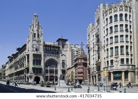 Barcelona, Spain - May 28, 2015: People and scooters in a street lined with historical buildings in downtown Barcelona, on May 28, 2015 in Barcelona, Spain - stock photo