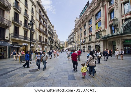 Barcelona, Spain - May 23, 2015: People walk in one of the main shopping streets (Portal de l'Angel) in Barcelona, Spain on May 23, 2015.