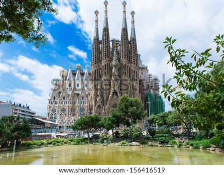 BARCELONA, SPAIN - MAY 12: Sagrada Familia on May 12, 2013 in Barcelona, Spain. The impressive cathedral designed by Antoni Gaudi is being built since 1882 and is not finished yet  - stock photo