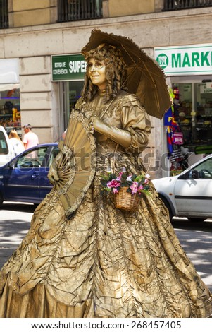 BARCELONA, SPAIN - MAY 17 2014 : Street actress in fairy tale style performance in the La Rambla street, Barcelona, Spain on May 17, 2014. - stock photo