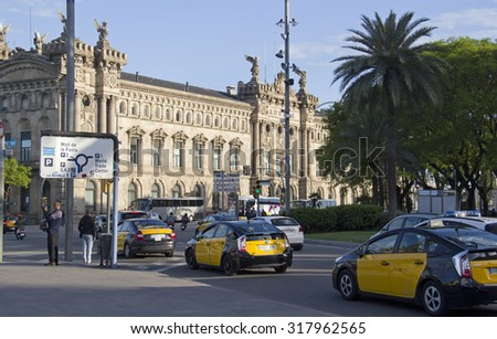 Barcelona, Spain - May 21, 2015: Taxi cabs and other traffic near the old customs building in Barceloneta, the harbor of Barcelona, Spain on May 21, 2015. - stock photo