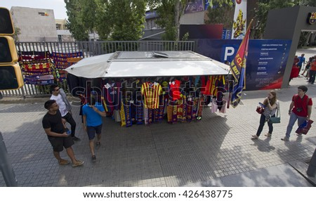 Barcelona, Spain - May 25 2015: Tourists and a merchandise shop at the gate of the stadium of FC Barcelona in Barcelona in Spain on May 25 2015. - stock photo