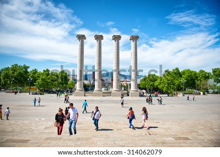 BARCELONA, SPAIN - MAY 02: Tourists Gathered Around Les Quatres Columnes, The Four Columns, a Major Tourist Attraction Located in Barcelona, Spain. May 02, 2015. - stock photo