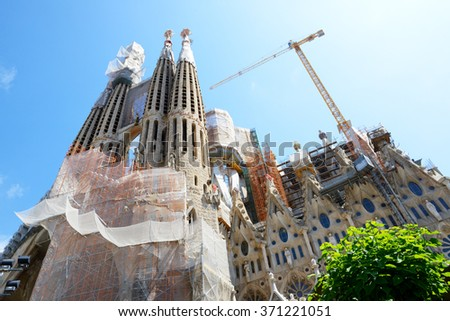 BARCELONA, SPAIN - MAY 27, 2015: View on construction of the Basilica of the Sagrada Familia on May 27, 2015 in Barcelona, Spain. Up to 60 mln tourists is expected to visit Spain in year 2015. - stock photo