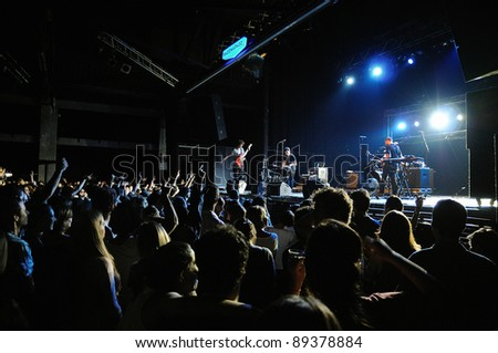 BARCELONA, SPAIN - NOV 22: The Rapture band performs at Razzmatazz on November 22, 2011 in Barcelona, Spain. - stock photo