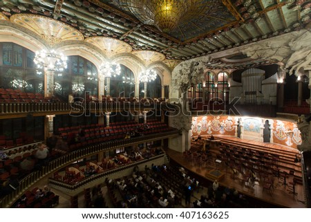 BARCELONA, SPAIN - NOVEMBER 26, 2015: Audience and orchestra at the concert Cicle Caral Orfeo Catala in music hall Palau de la Musica Catalana, Catalonia - stock photo