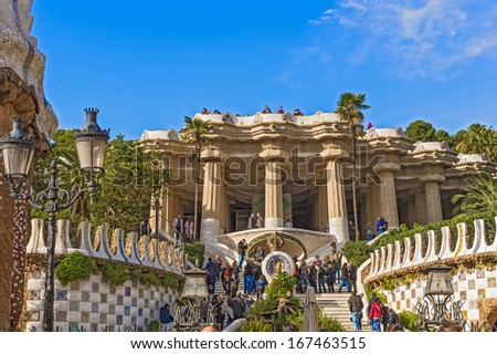 Barcelona, Spain - November 23: Entrance at the Guell Park in Barcelona, on November 23, 2013. One of the most visited sites in Barcelona, Spain, and it is UNESCO World Heritage Site.