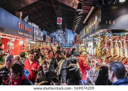 BARCELONA, SPAIN - NOVEMBER 16, 2013: Famous La Boqueria market - one of the oldest markets (Established in 1217) in Europe that still exist. A huge selection of meat, sweets, fruits and vegetables. - stock photo