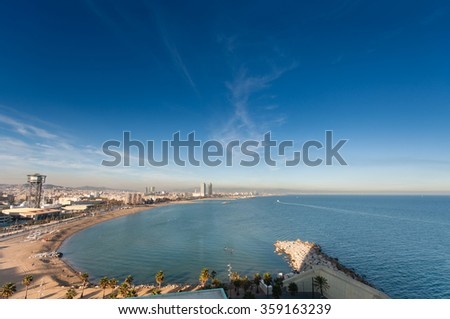 BARCELONA, SPAIN - NOVEMBER 10, 2015: Panoramic view of city seascape with San Sebastian, San Miguel and Barceloneta beaches on November 10, 2015 in Barcelona, Spain. - stock photo