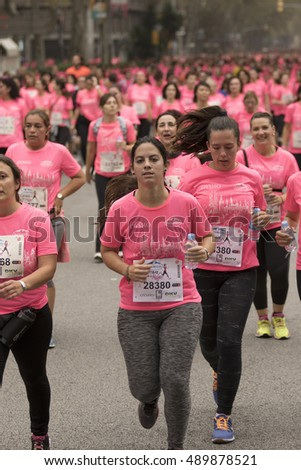 Barcelona, Spain- November 8, 2015: Participants of the annual Breast Cancer Awareness Run on the streets of Barcelona.