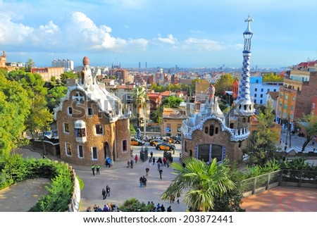 "BARCELONA, SPAIN - NOVEMBER 6, 2012: People visit Park Guell in Barcelona, Spain. It was built in 1900-14 and  is part of the UNESCO World Heritage Site ""Works of Antoni Gaudi""."