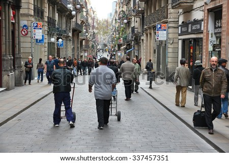BARCELONA, SPAIN - NOVEMBER 6, 2012: People walk Carrer de Ferran street in Barcelona. According to Mastercard, Barcelona is the 15th most visited city worldwide (7.5m in 2012).