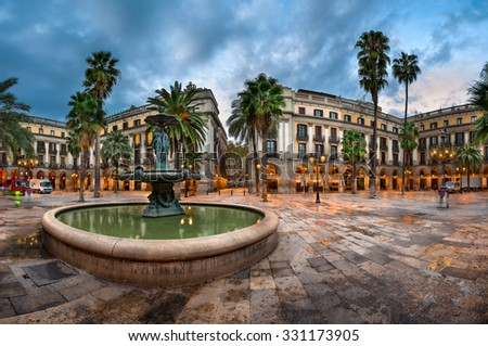 BARCELONA, SPAIN - NOVEMBER 17, 2014: Placa Reial in Barcelona, Spain. The square, with lanterns designed by Gaudi and the Fountain of Three Graces in the center.