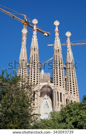 Barcelona, Spain - November 9, 2015: Sagrada Familia is a large Roman Catholic church, designed by Antoni Gaudi. Although incomplete, UNESCO World Heritage Site. - stock photo