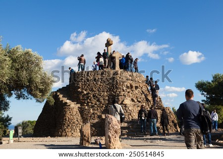 BARCELONA, SPAIN - NOVEMBER 15: Tourists in Turo de Les Tres Creus where Gaudi­ wanted to finish his work from Park Guell. Built with prehistoric remains, on November 15, 2014 in Barcelona, Spain - stock photo