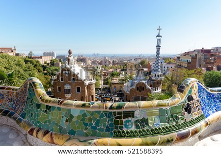 Barcelona, Spain - Ocktober 10, 2011: Tourist at the Park Guell. The Park Guell is a public park system composed of gardens and architectonic elements located on Carmel Hill, in Barcelona, Catalonia.