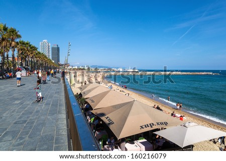 BARCELONA, SPAIN - OCTOBER 13: beach of Barceloneta with unidentified people on October 13, 2013 in Barcelona. The famous city beach of Barcelona is 1100 meters long. - stock photo