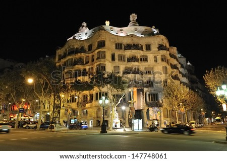 BARCELONA, SPAIN - OCTOBER 6 : Casa Mila, one of Antonio Gaudi's famous buildings illuminated at night on October 6 2010 in Barcelona, Spain - stock photo