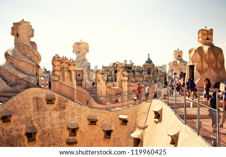 BARCELONA, SPAIN - OCTOBER 4: Casa Mila or La Pedrera on October 4, 2012 in Barcelona, Spain. This famous building was designed by Antoni Gaudi and is one of the most visited of the city. - stock photo