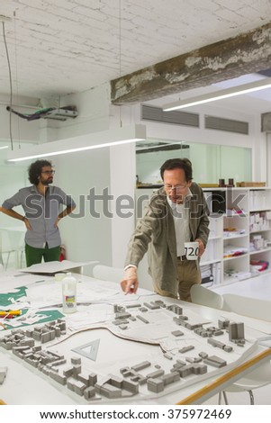 BARCELONA, SPAIN - OCTOBER 7,2015: Engineer men developing architecture project - stock photo