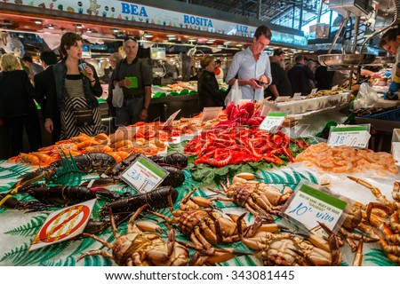 BARCELONA, SPAIN - OCTOBER 23,2015: Famous La Boqueria market with seafood and unidentified people. One of the oldest markets in Europe that still exist