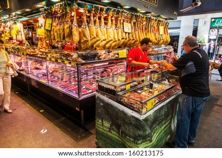 """BARCELONA, SPAIN - OCTOBER 14: in the market hall """"La Boqueria"""" on October 14, 2013 in Barcelona. The famous historical market hall has about 2.600 square meters and is a tourist attraction. - stock photo"""