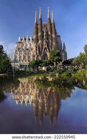 BARCELONA, SPAIN - OCTOBER 8: La Sagrada Familia - cathedral designed by Antonio Gaudi, which is being build since 1882 and not finished yet, October 8, 2014 in Barcelona, Spain.  - stock photo