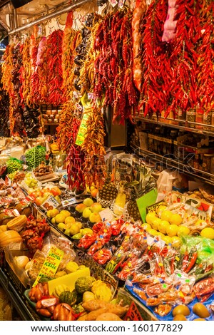BARCELONA, SPAIN - OCTOBER 14: market stall in the market hall La Boqueria on October 14, 2013 in Barcelona. La Boqueria is a famous and historical market hall on about 2.600 square meters. - stock photo