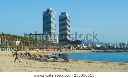 BARCELONA, SPAIN, OCTOBER 24, 2014: People are enjoying strolling on the promenade leading to the world biggest city beach in barcelona.