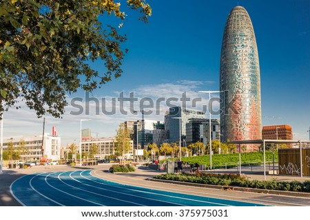 BARCELONA, SPAIN - OCTOBER 22, 2015: View of the Agbar Tower and the Museum of Design in Barcelona, Spain - stock photo