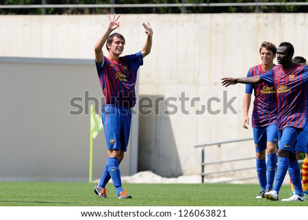 BARCELONA, SPAIN - SEP 11: Jordi Quintilla Guasch plays with F.C Barcelona youth team against Manlleu on September 11, 2011 in Barcelona, Spain. - stock photo