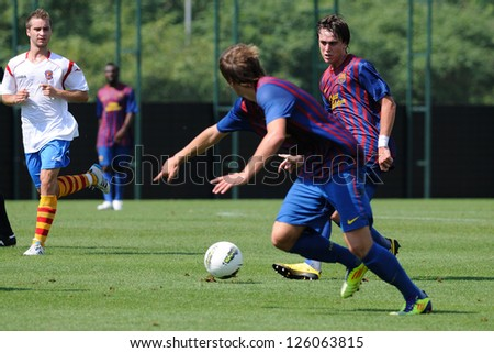 BARCELONA, SPAIN - SEP 11: Patricio Gabarron Gil Patri plays with F.C Barcelona youth team against Manlleu on September 11, 2011 in Barcelona, Spain. - stock photo
