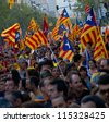 BARCELONA, SPAIN - SEPT. 11: Participants in the rally for the independence during the National Day of Catalonia on Sept. 11, 2012 in Barcelona, Spain. About 1.5 million people participated. - stock photo