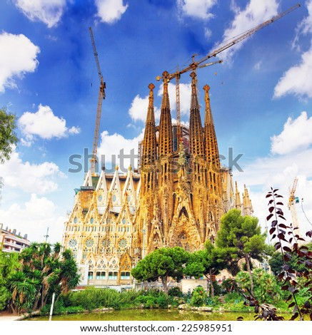 BARCELONA, SPAIN - SEPT 02, 2014:The Basilica of La Sagrada Familia against blue sky.Fabulous creations of the great architect  by Antoni Gaudi, its construction began in 1882 and is not finished yet. - stock photo