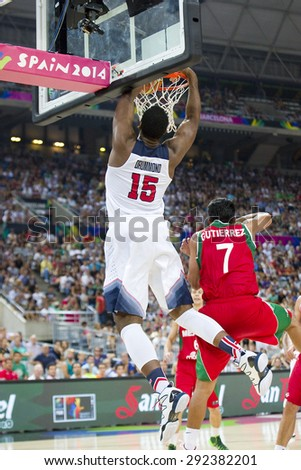 BARCELONA, SPAIN - SEPTEMBER 6: Andre Drummond of USA Team in action at FIBA World Cup basketball match between USA and Mexico, final score 86-63, on September 6, 2014, in Barcelona, Spain. - stock photo