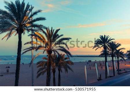 BARCELONA, SPAIN - SEPTEMBER 17; Barcelona waterfront at dusk, retro colors as darkness arrives in Olympic Port district on September 17, 2016, Barcelona Spain