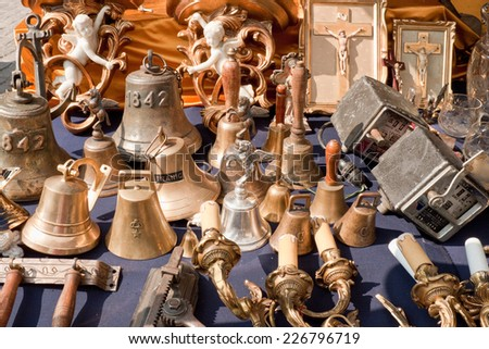 Barcelona, Spain - September 26, 2014: Bells and other vintage things for sale on an outdoor flea market in Barcelona.