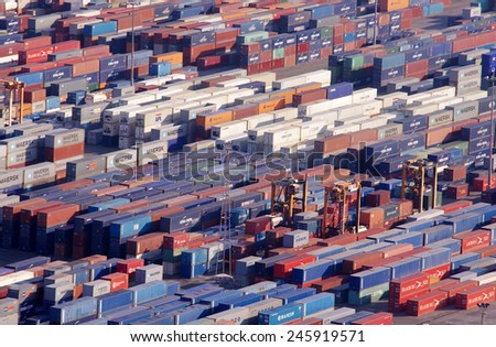 BARCELONA, SPAIN - SEPTEMBER 28, 2011: Cargo containers at the industrial part of the Port of Barcelona. view from Montjuic hill in Barcelona, Spain.  - stock photo
