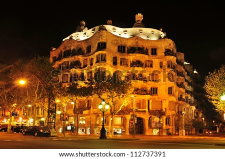BARCELONA, SPAIN - SEPTEMBER 10: Casa Mila, or La Pedrera, at night on September 10, 2012 in Barcelona, Spain. This famous building, placed in Passeig de Gracia, was designed by Antoni Gaudi - stock photo