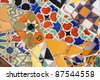 BARCELONA, SPAIN - SEPTEMBER 13: Colorful mosaic in famous Parc Guell on September 13, 2009 in Barcelona, Spain. Gaudi's creations are on of major factors influencing tourism in Barcelona. - stock photo