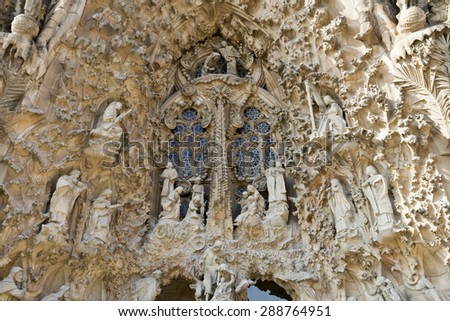 BARCELONA, SPAIN - SEPTEMBER 13, 2014: Detail of the highly decorated Nativity Facade of the Basilica of the Holy Family (Sagrada Familia) in Barcelona, Spain - stock photo