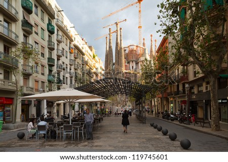 BARCELONA,SPAIN-SEPTEMBER 26:Famous Basilica y Templo Expiatorio de la Sagrada Familia at the end of Avinguda Gaudi,on September 26,2012 in Barcelona.Part of the UNESCO World Heritage Site. - stock photo