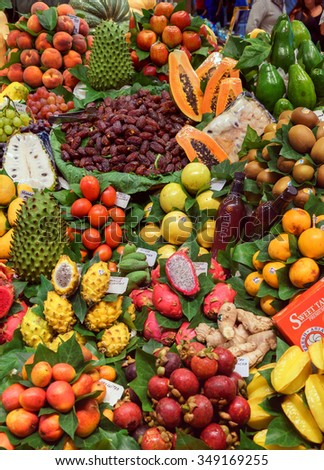 BARCELONA, SPAIN - September 29: Fresh Fruits on September 29, 2015 in Barcelona, Spain. Famous La Boqueria market / photography of the variety of fruits at the market.